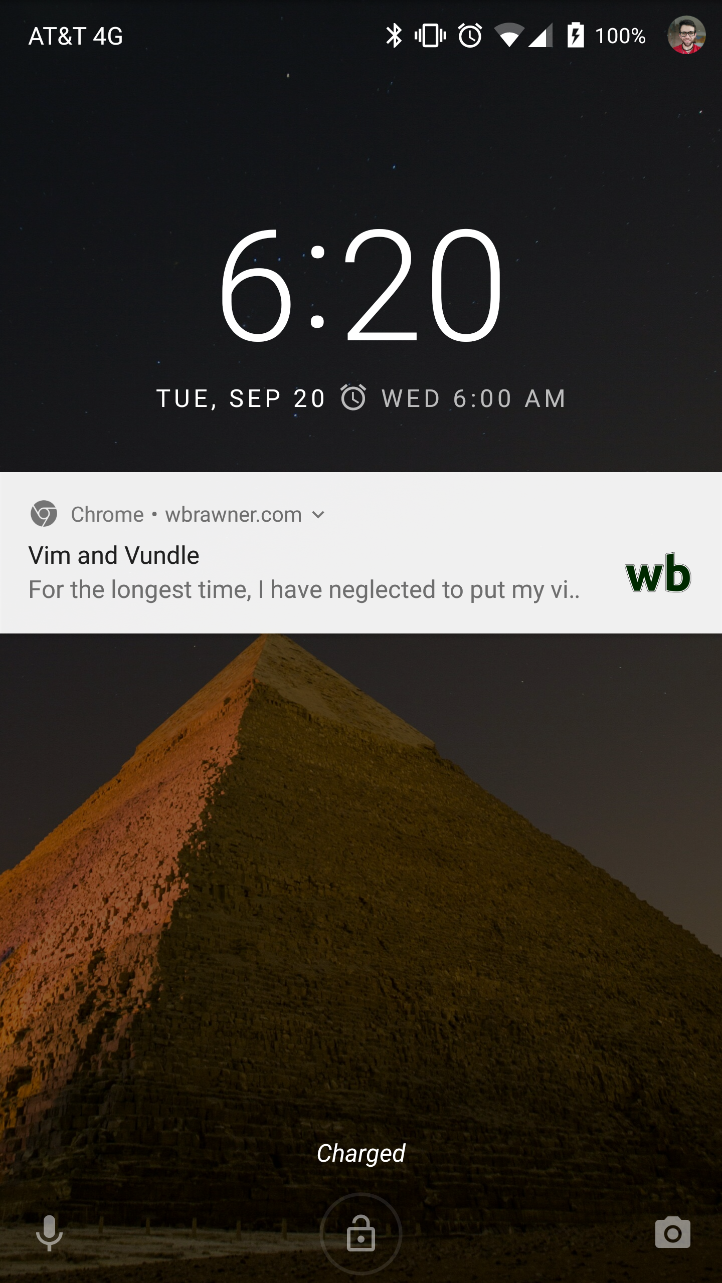 A screenshot of an Android phone lock screen shows a notification of a new post from my blog